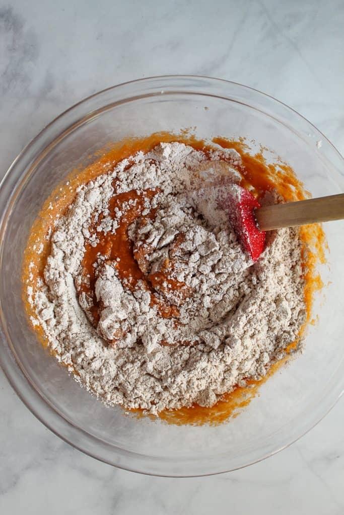 gluten free pumpkin muffins batter in a glass bowl.