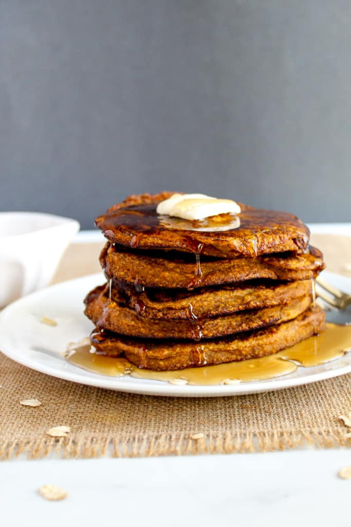 stack of gluten free pumpkin pancakes on a plate