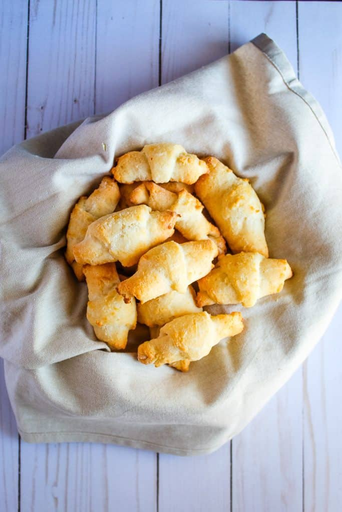 Gluten free crescent rolls in a basket on a counter