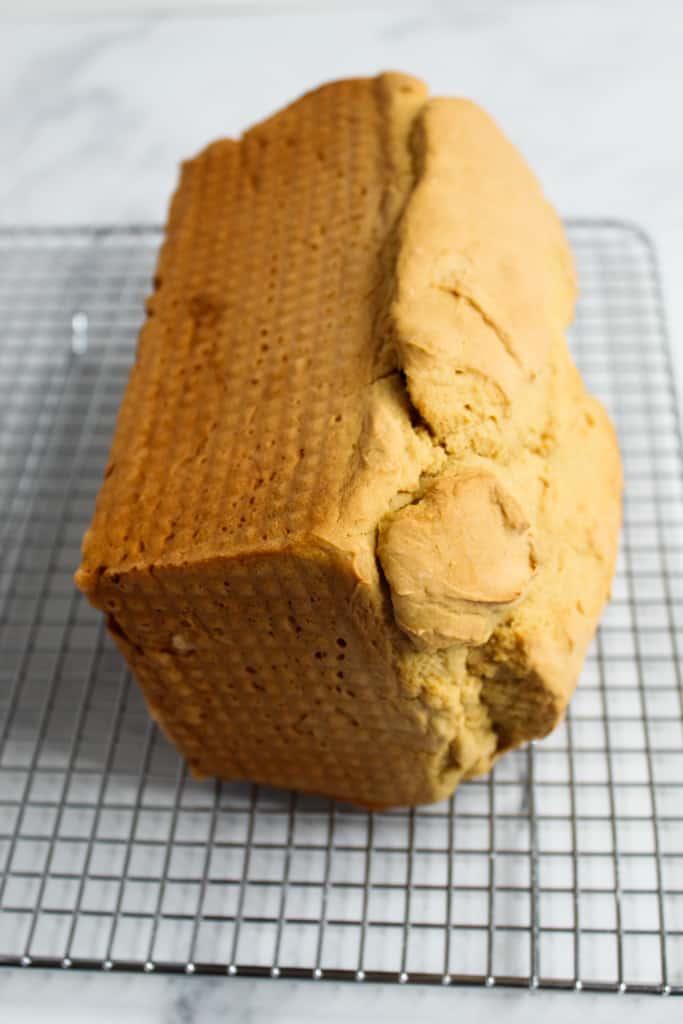 gluten free sandwich bread cooling on a wire rack