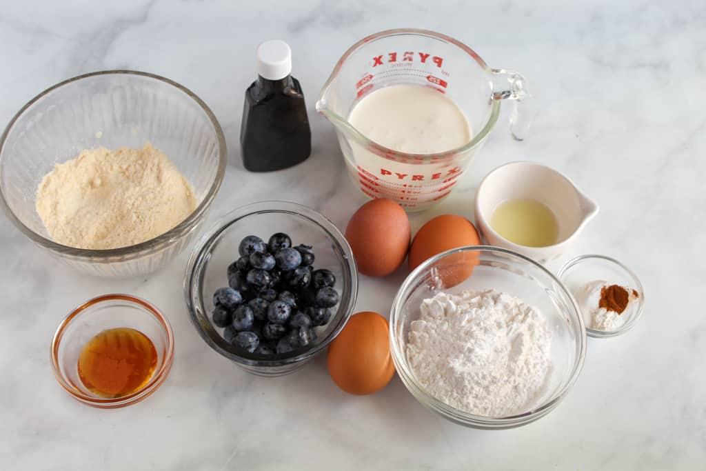 gluten free blueberry pancakes ingredients on a white countertop