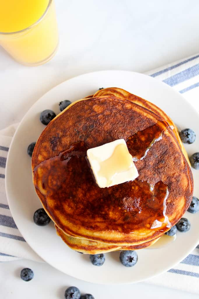 gluten free blueberry pancakes served on a white plate