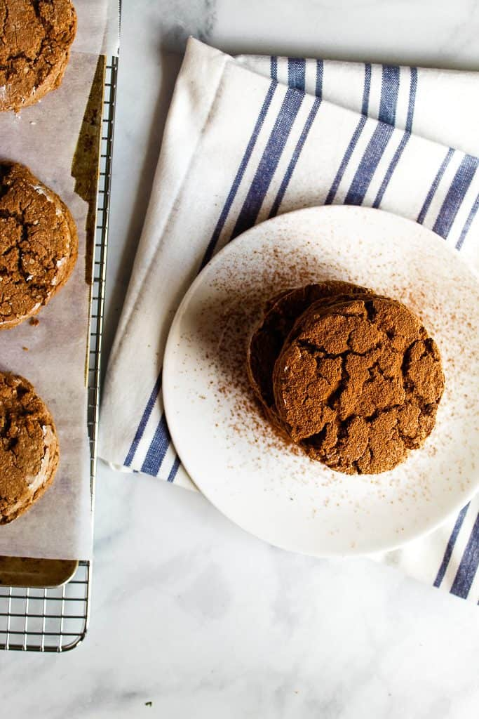 gluten free chocolate biscuits on a white plate.