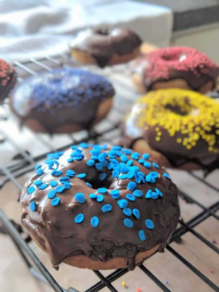 gluten free cake donuts baked with chocolate glaze on top.