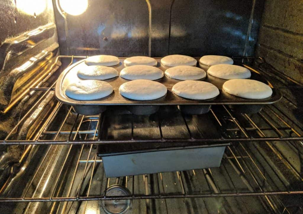 rolls baking in the oven in a metal pan
