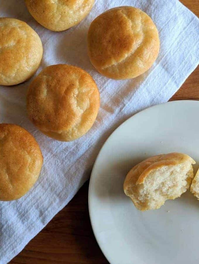 gluten free dairy free dinner rolls on a white plate
