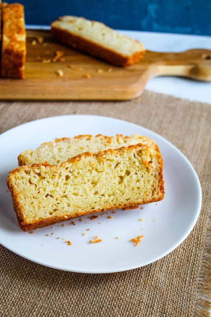 slice of gluten free garlic bread on a white plate