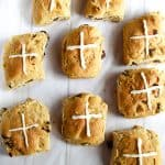gluten free hot cross buns on a cookie sheet