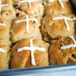 gluten free hot cross buns in a metal pan