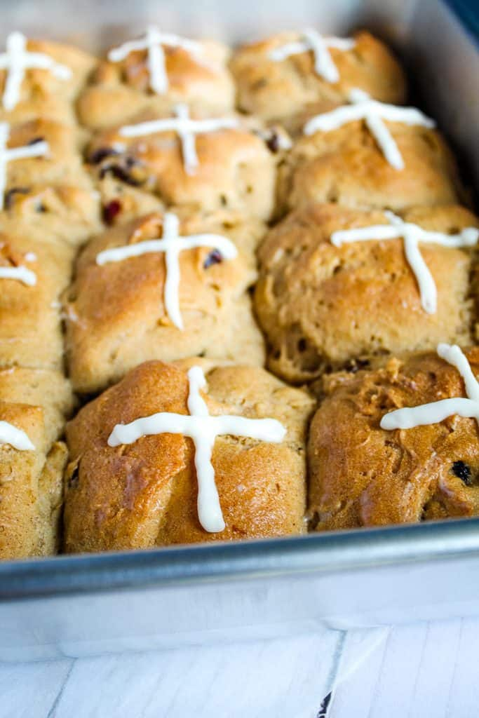 gluten free hot cross buns in a metal pan