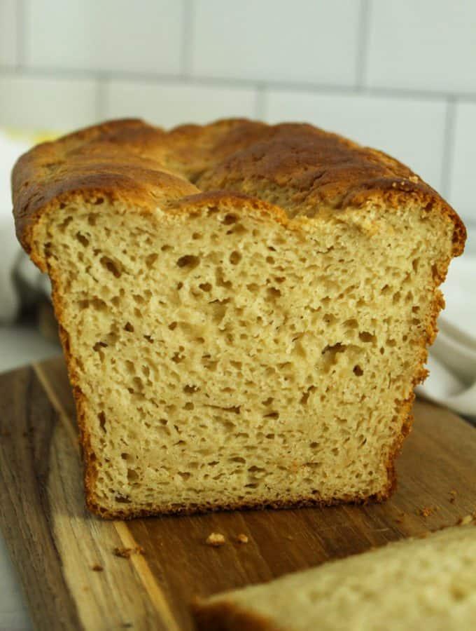 gluten free hawaiian bread sliced on a brown cutting board