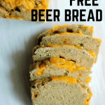 gluten free beer bread sliced on a white paper.