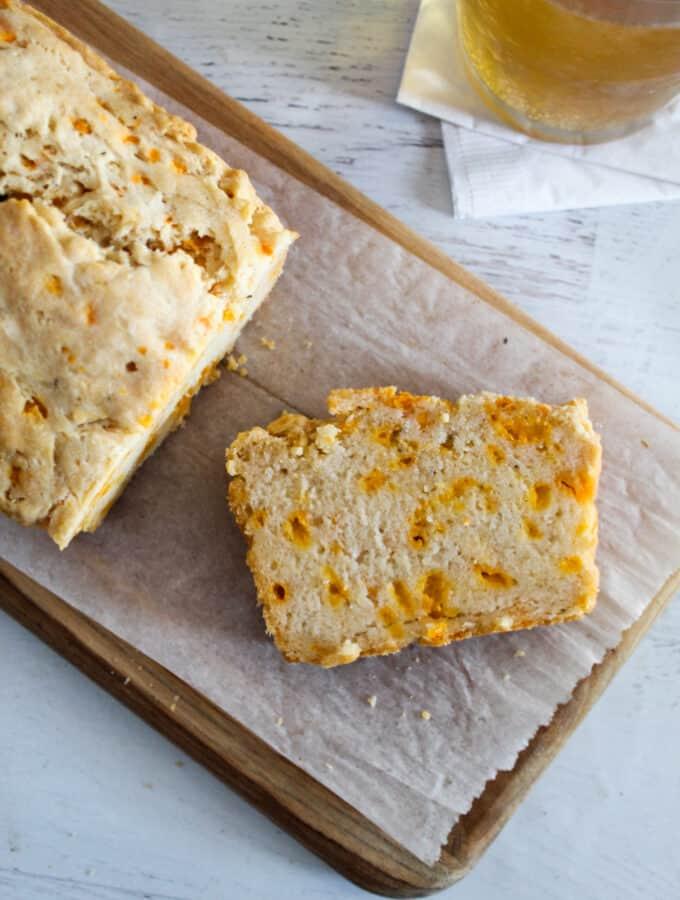 slice of bread sitting on a cutting board