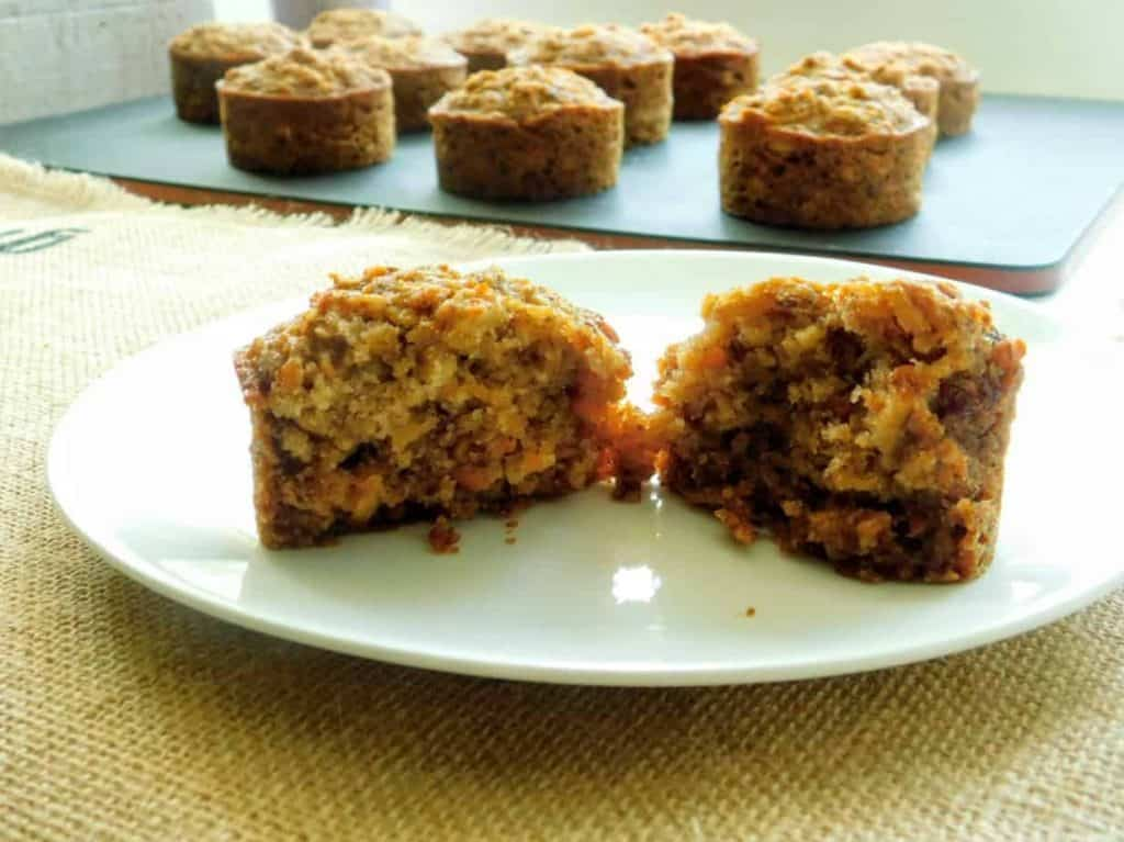 gluten free carrot apple muffins on a white plate