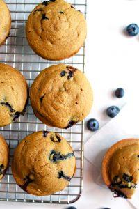 gluten free lemon blueberry muffins sitting on a wire rack