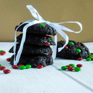 gluten free chocolate cake cookies wrapped in a ribbon on a white board