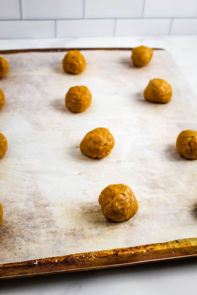 side shot of cookie balls on pan
