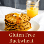 gluten free buckwheat pancakes on a white plate with syrup pouring down