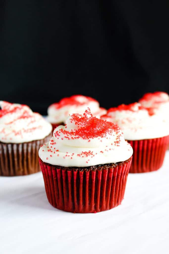 gluten free red velvet cupcakes in a red liner on a white counter