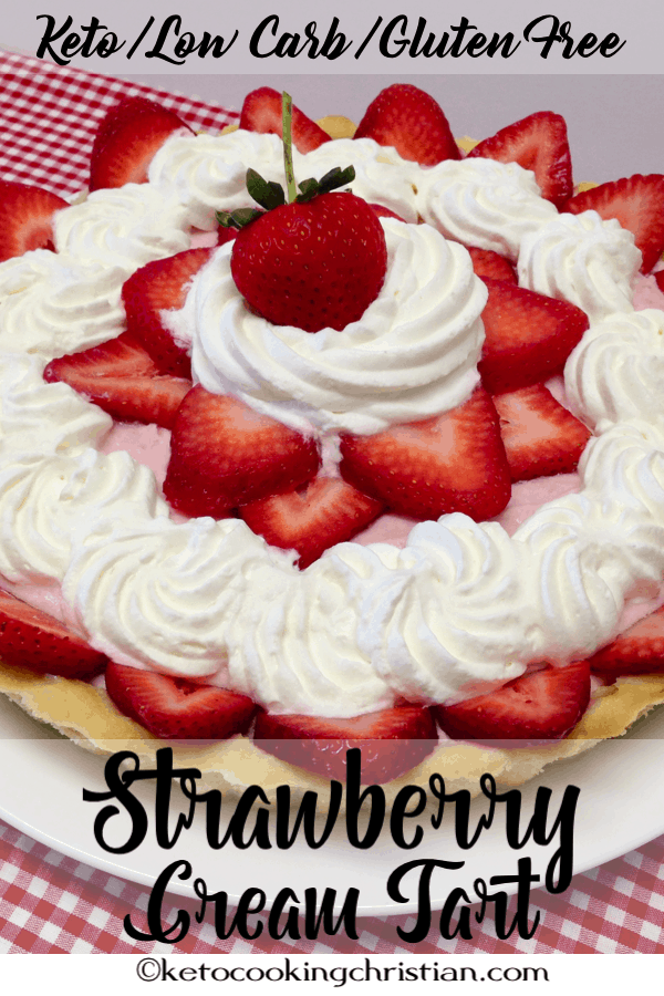 strawberry cream tart with whipped cream on a plate