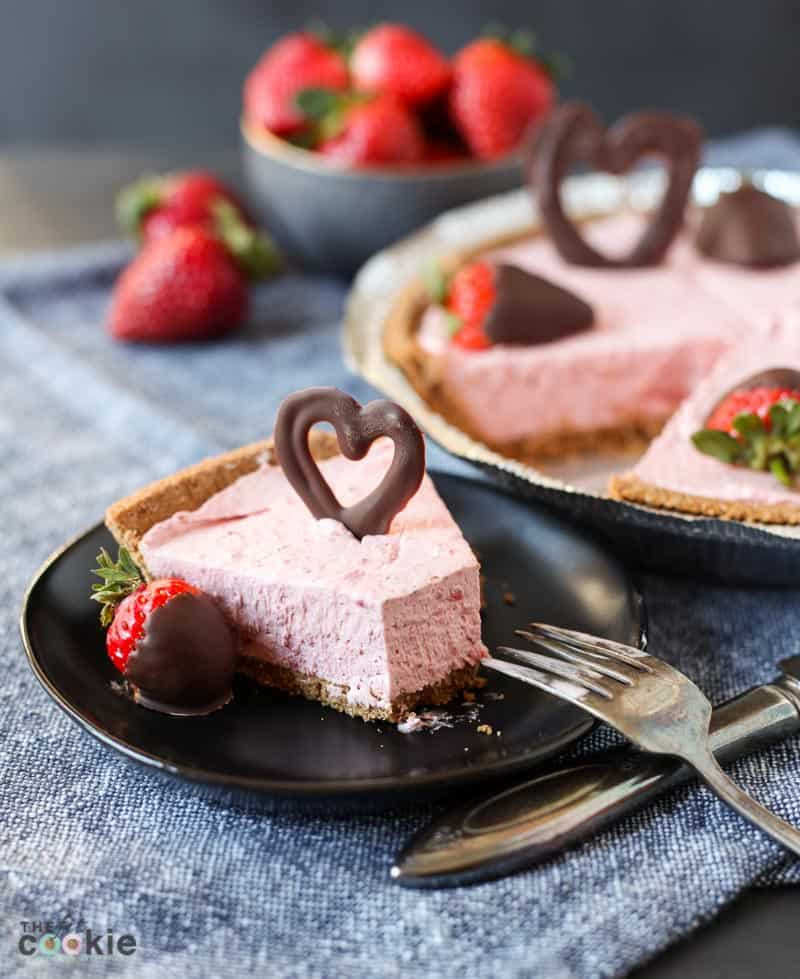 strawberry cheesecake on a black plate