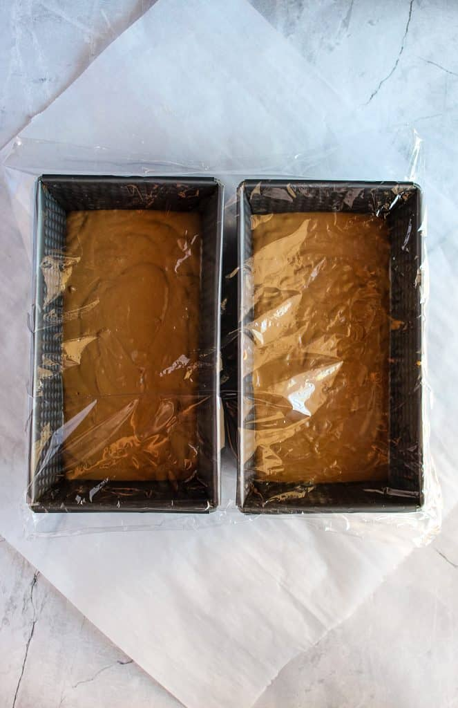 gluten free pumpernickel bread dough in pans