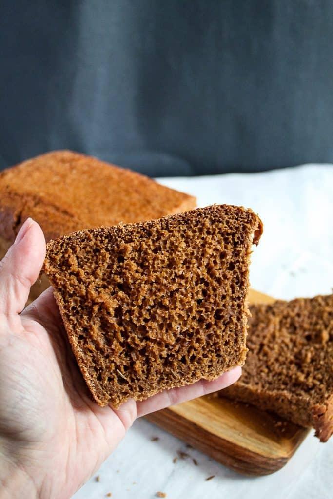 Gluten free pumpernickel bread slice showing texture