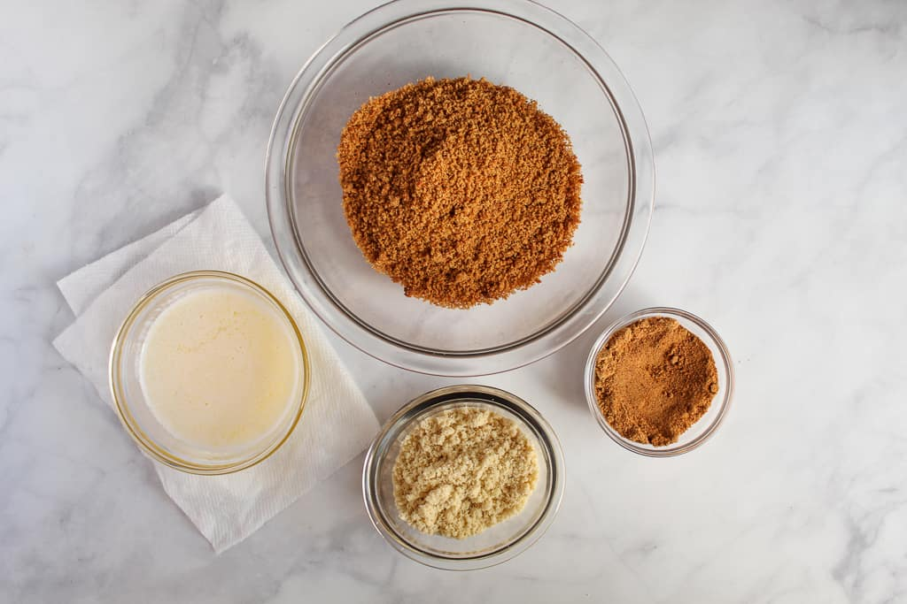 almond flour graham cracker crust ingredients on a white countertop