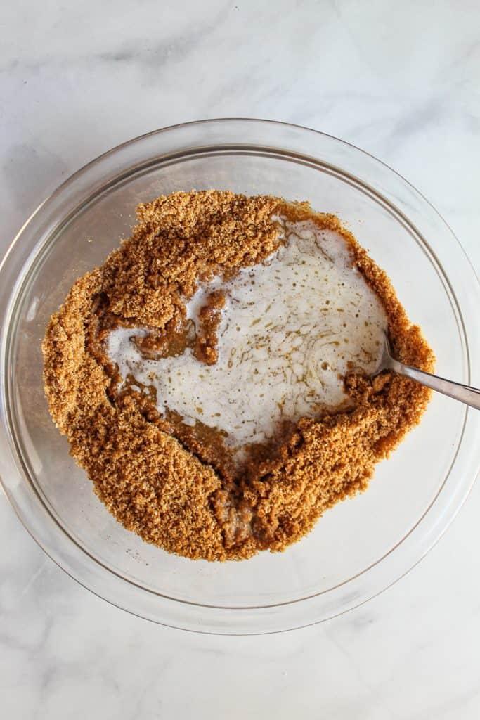 almond flour graham cracker crust mix in a glass bowl
