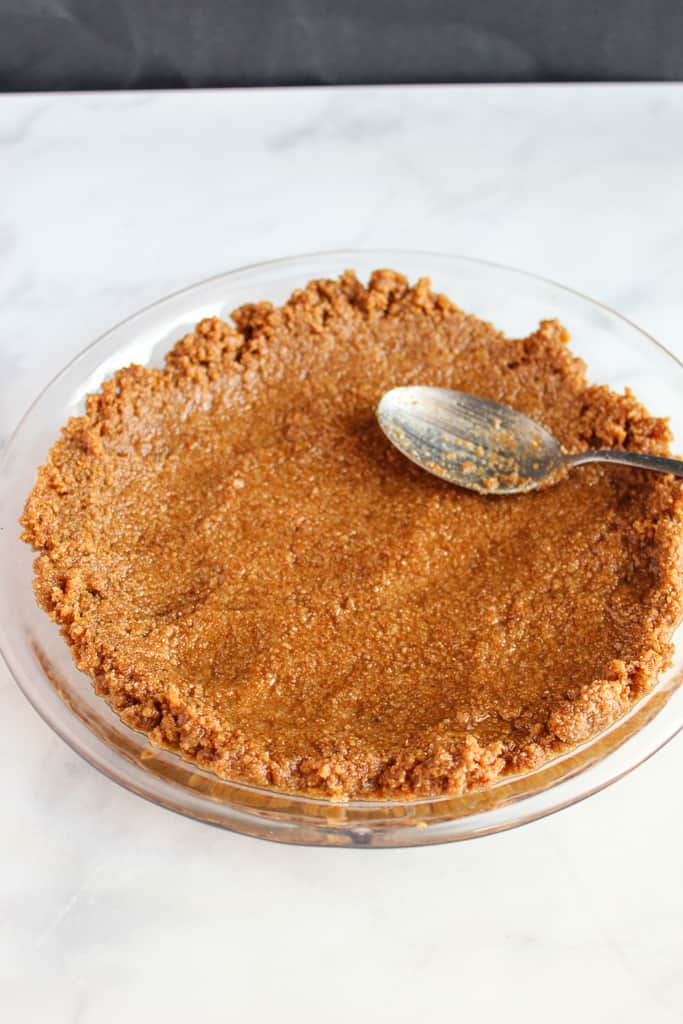 almond flour graham cracker crust in a pie plate.