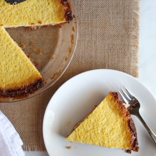 slice of gluten free buttermilk pie on a white plate