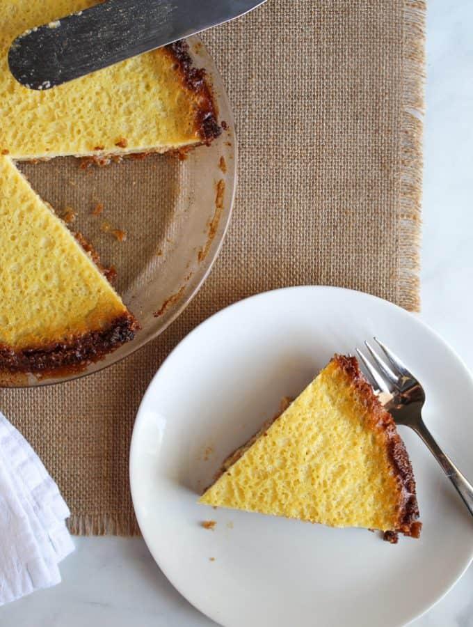 slice of gluten free buttermilk pie on a white plate