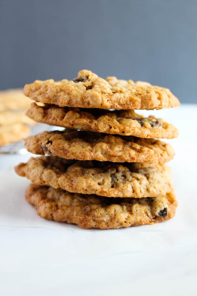 gluten free oatmeal raisin cookies stacked on a white counter