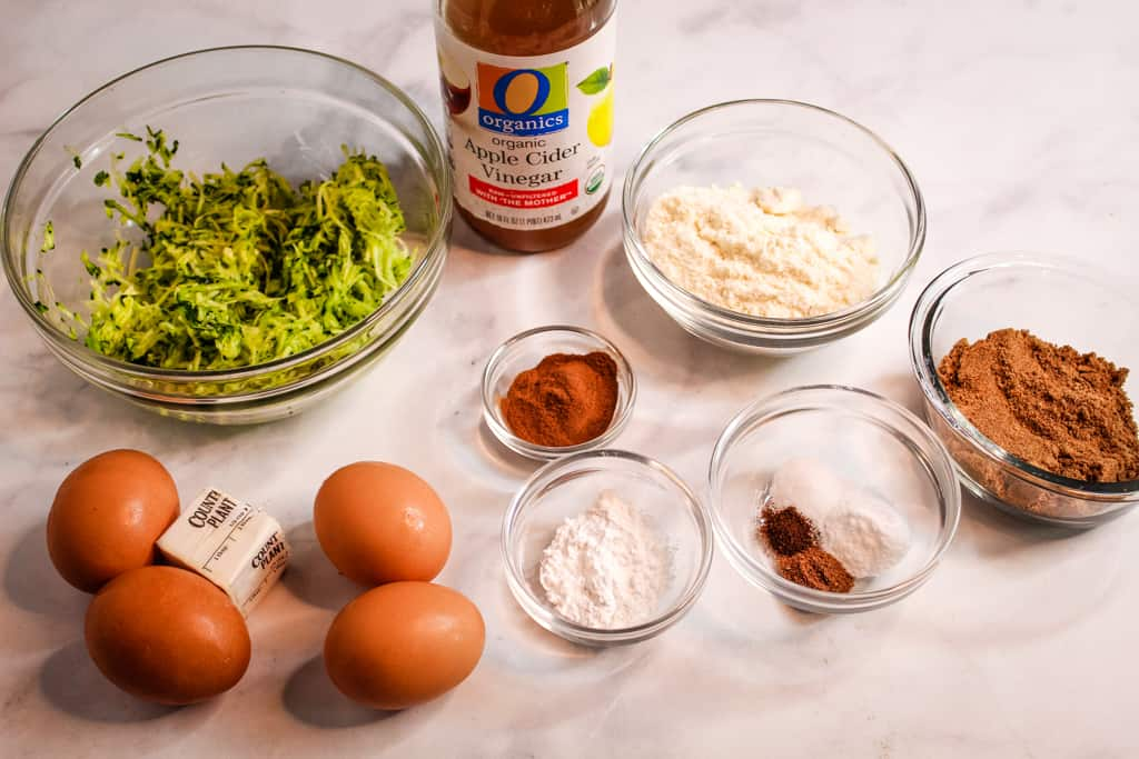 coconut flour zucchini bread ingredients on a counter