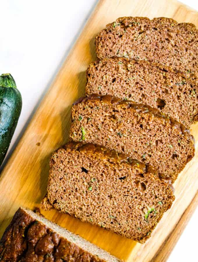 coconut flour zucchini bread sliced on a wooden board