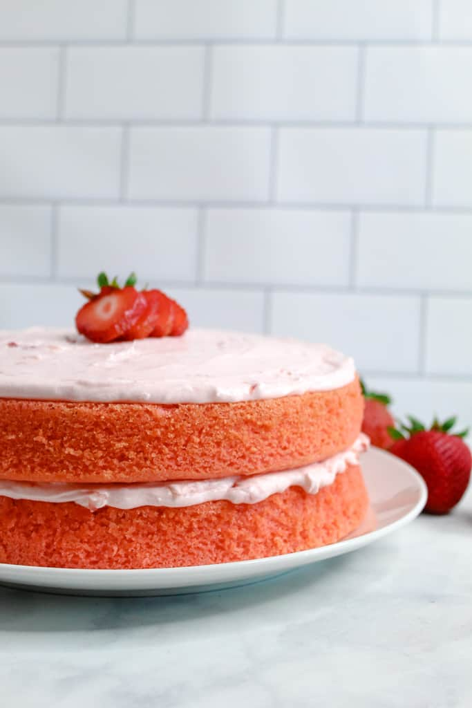 gluten free strawberry cake whole cake on a plate