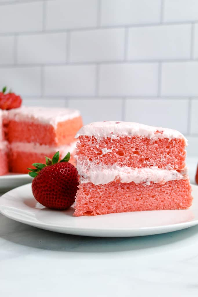 gluten free strawberry cake slice served on a white plate