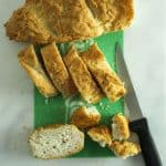 Gluten Free French Toast Casserole slicing bread on a cutting board