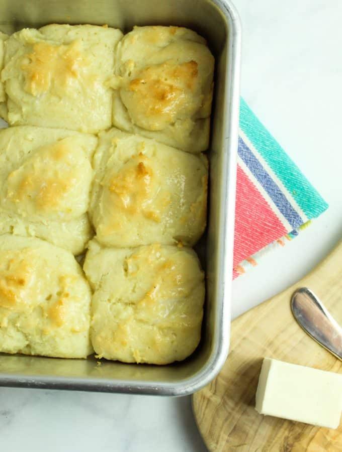 gluten free potato rolls after baking, sitting in a pan