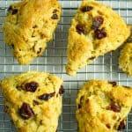 baked gluten free cranberry orange scones sitting on a wire rack