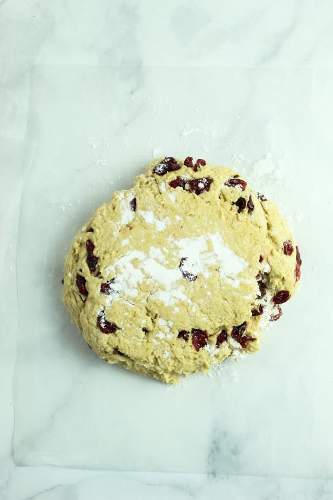 gluten free cranberry orange scones dough in a disk