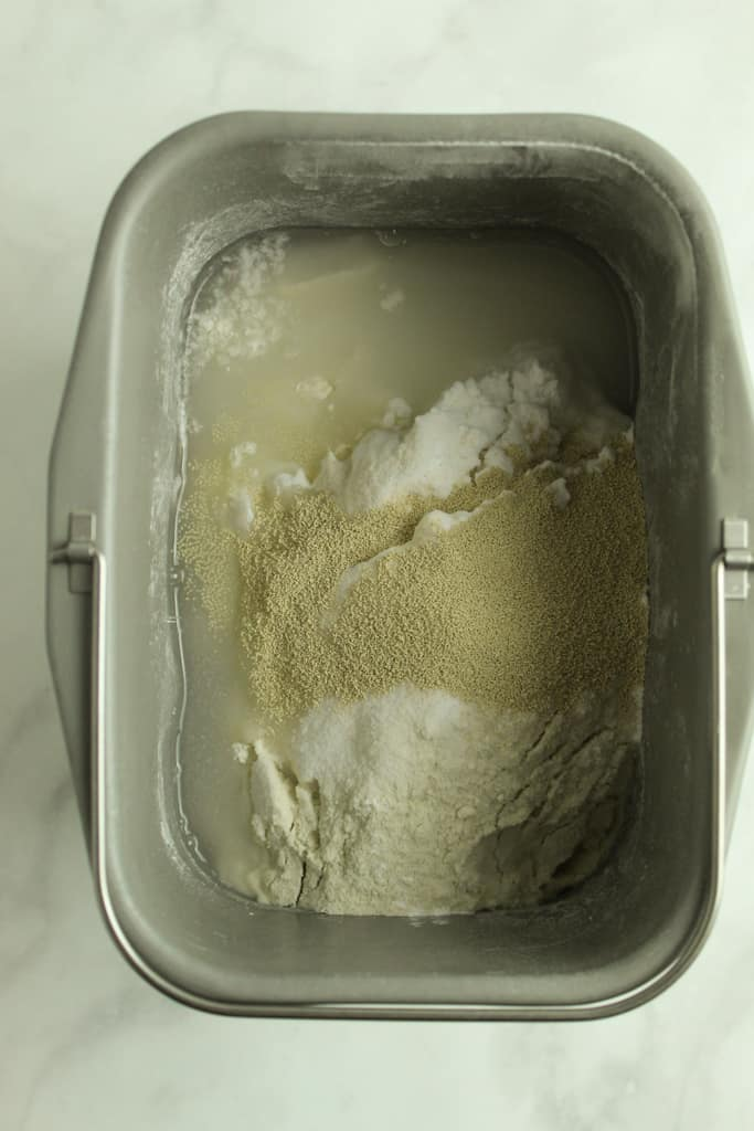 adding ingredients to the bread machine