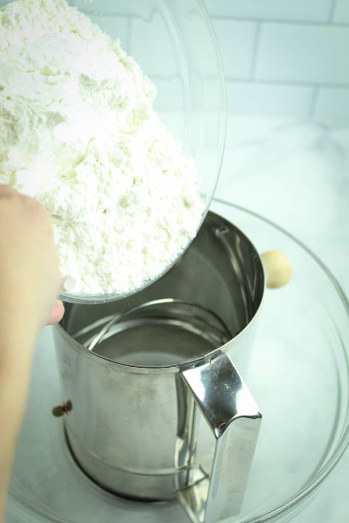 sifting flour into a bowl