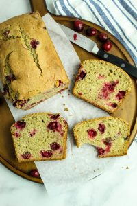 slices of gluten free cranberry orange bread on a platter