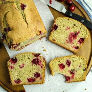 slices of gluten free cranberry orange bread on a platter