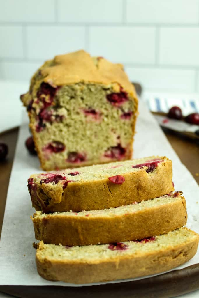sliced loaf of gluten free cranberry orange bread