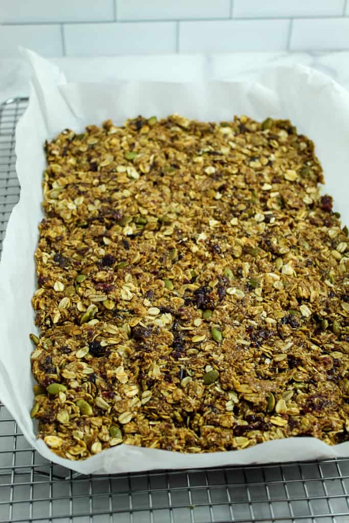 homemade granola bas cooking on a rack