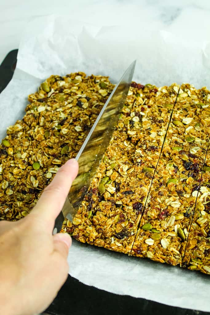 slicing granola bars with a knife