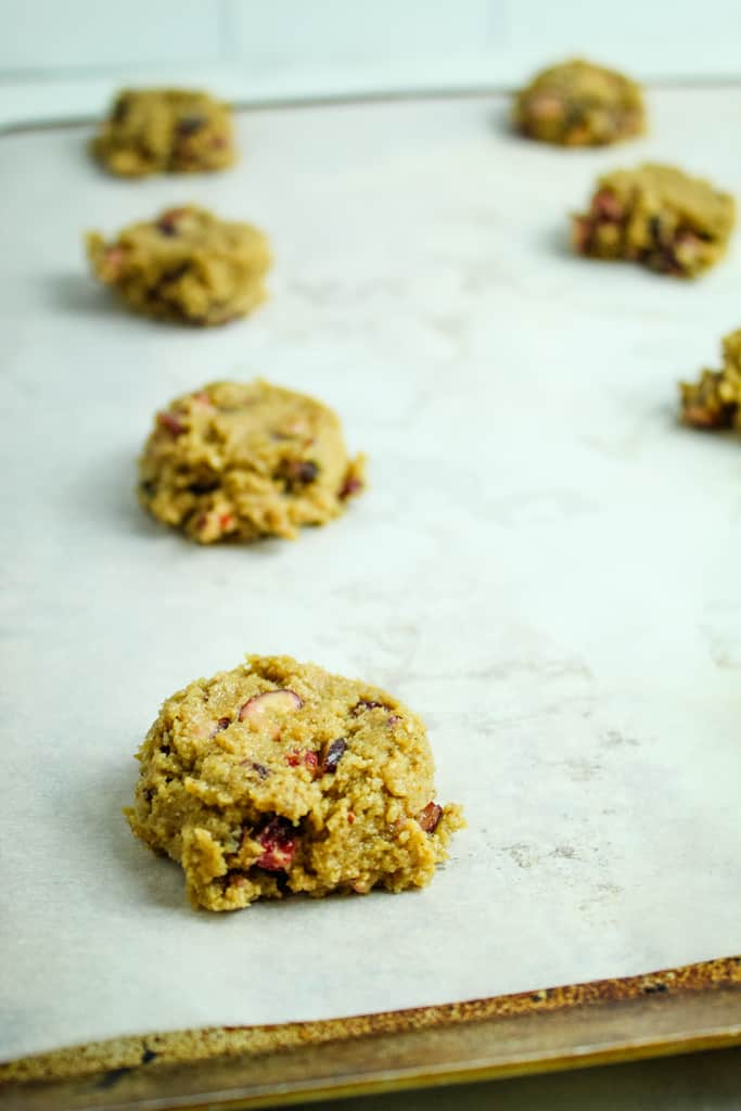 gluten free cranberry cookie dough on baking sheet lined with parchment paper