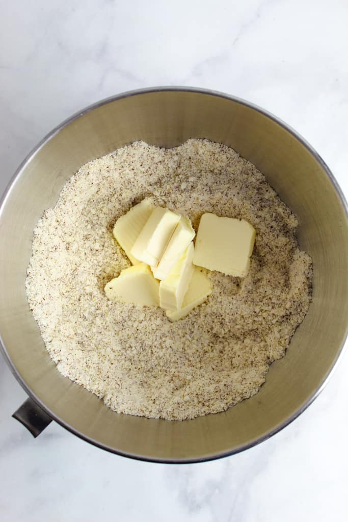 overhead shot of butter in dry ingredients